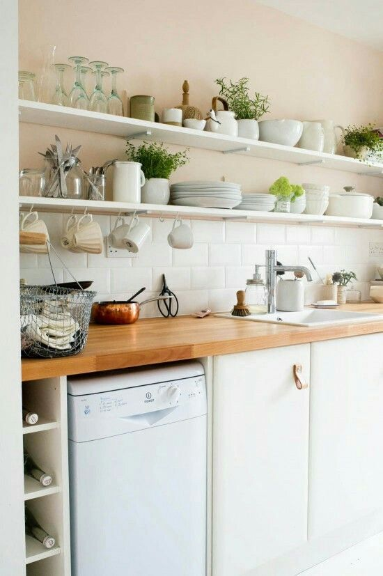 Small kitchen makeover using metro tiles, open shelving and beech worktop.