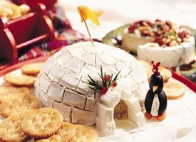 Festive Appetizer~ Igloo Spread with Cream Cheese Penguins~ Kids love helping make this fun appetizer. Plan a family day in the kitchen a day before your party to allow plenty of time to enjoy creating this Arctic treat.