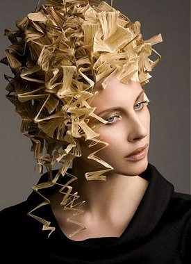 A long blonde straight wavy spikey crimped quirky avant garde hairstyle by Steven Carey
