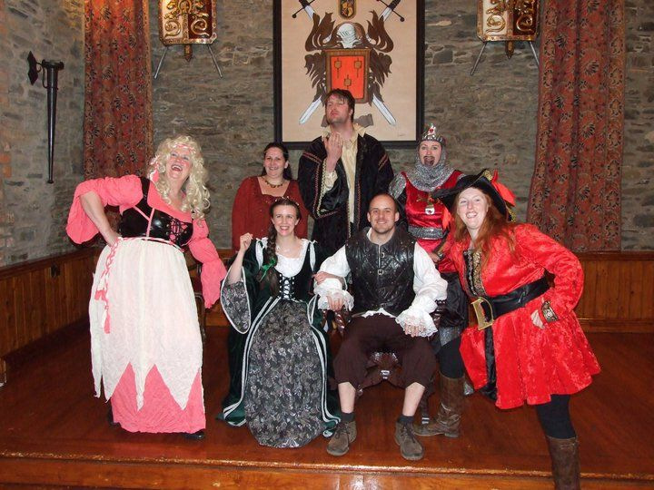 Our old business use to be organising Murder Mystery Evening, it was great fun. Here is a picture of Scott (Tall guy at the back :) ), me in the red outfit on the front row at our Murder Mystery event called A Knight Of Murder