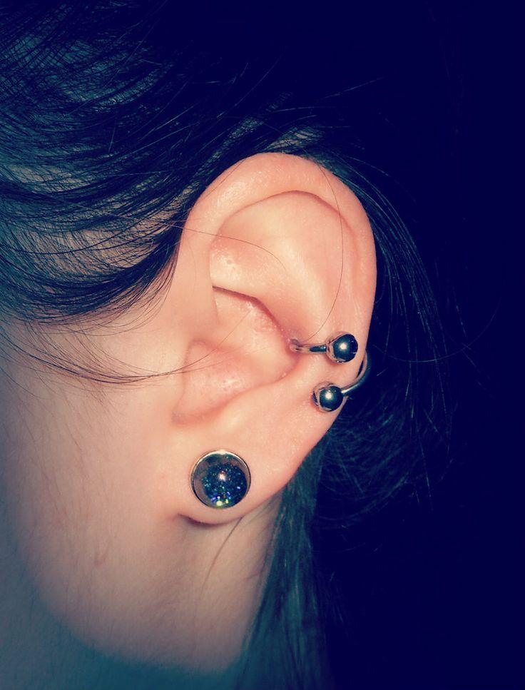 Spiral conch piercing ...