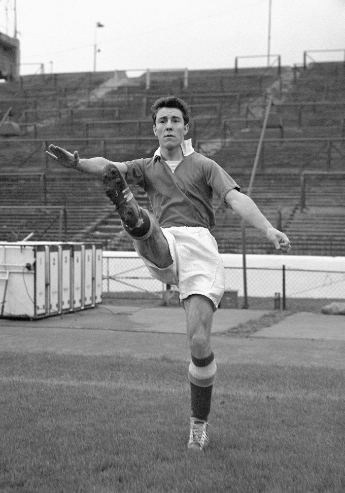 Chelsea striker Jimmy Greaves warms up at Stamford Bridge, 1957