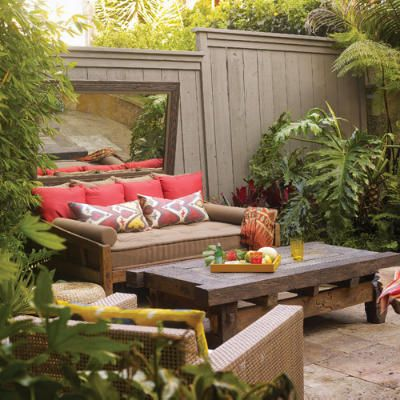 "Mirror, mirror, on the wall! Make my yard BIG, not small! A beat-up old fence can provide the best back drop for this ""living room in your backyard"" approach."