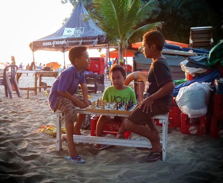 Boys playing chess on Legian Beach, Bali: