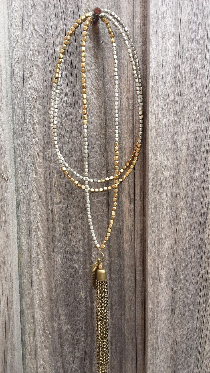 metal beaded long necklace with chain tassel.