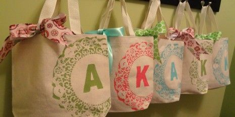Make your own monogrammed tote bags using a doily and freezer paper. Use it as a gift or party favor bag instead of a paper one.