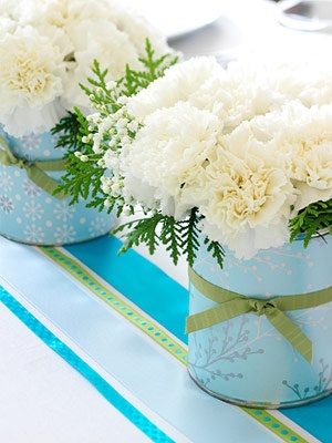 Coffee cans covered with wrapping paper ....decorating on a budget. Click for more easy ideas!