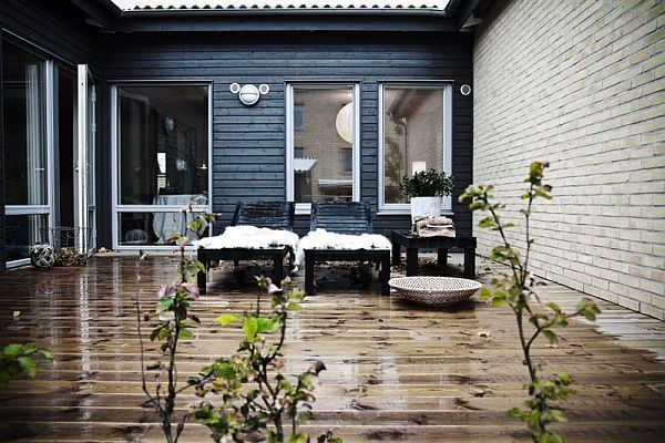 a lovely outdoor space... possibly the loveliest colour combination... grey exterior and timber decking...