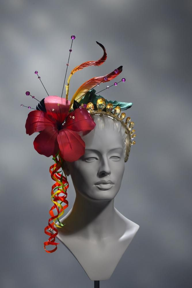 Model Millinery | Stephen Jones millinery I like the look of this piece as it has lots of colour and vibrancy. There are small added details like the beads which give the headpiece more elements and components. Small swirls have been added to the side which I think adds diversity and a unique feel to the head piece.