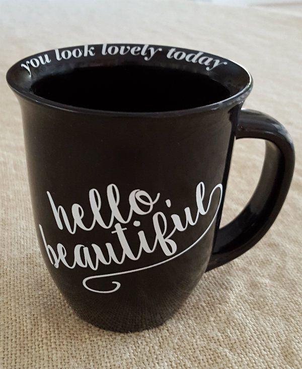 """HELLO, BEAUTIFUL"" coffee mug. Around the inside lip of the mug it says ""you look lovely today""."