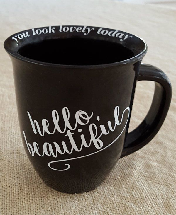 """HELLO, BEAUTIFUL"" coffee mug. Around the inside lip of the mug it says ""you look lovely today""."