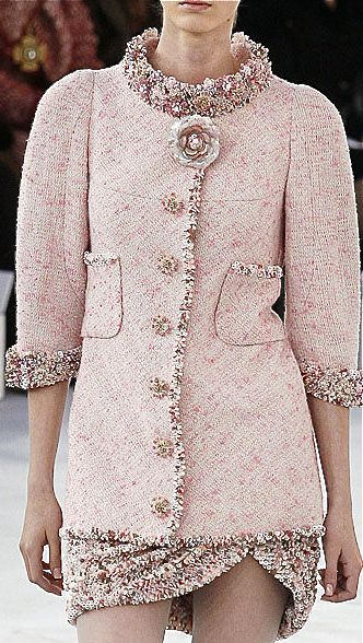 This Chanel coat has a somewhat feminine cut, yet I Find the sleeves, pocket placement and collar to be unflattering. I also feel that the embellishment of the large flower is too much. I feel that Chanel is simplicity is elegance isn't portrayed here.