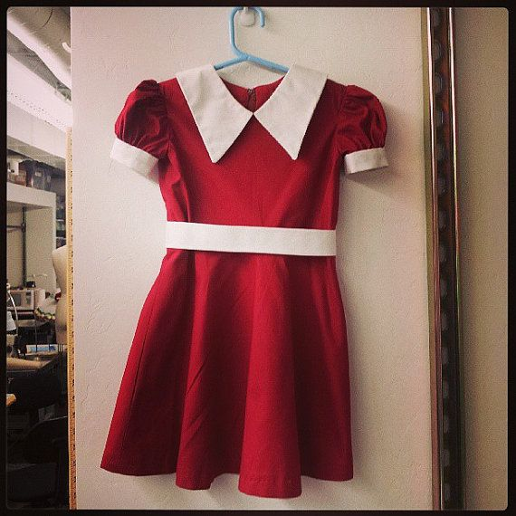 This is a custom-made Little Orphan Annie dress, for theatrical productions or Halloween. The photos are of a sample made for a production of Annie,