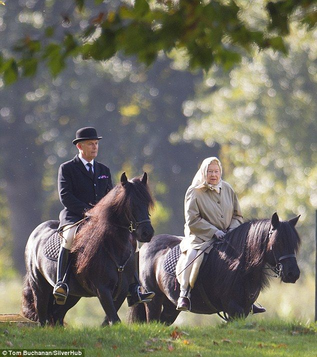 Long to rein over us: The Queen was spotted riding in Windsor with head groom Terry Pendry...