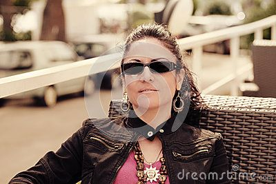 #Cool #Brunette #Woman #Relaxed #Casual #european #urban #person #enjoying #leisure #modern #attractive #lifestyle #portrait #adult #sunglasses #lady #pretty #female #brunette #sunny #people #natural #sitting #royaltyfree #stockphotos #Dreamstime