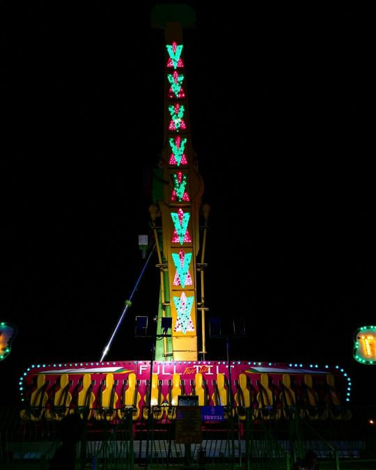 Carnival rides at night, Andouille Festival, louisiana, USA