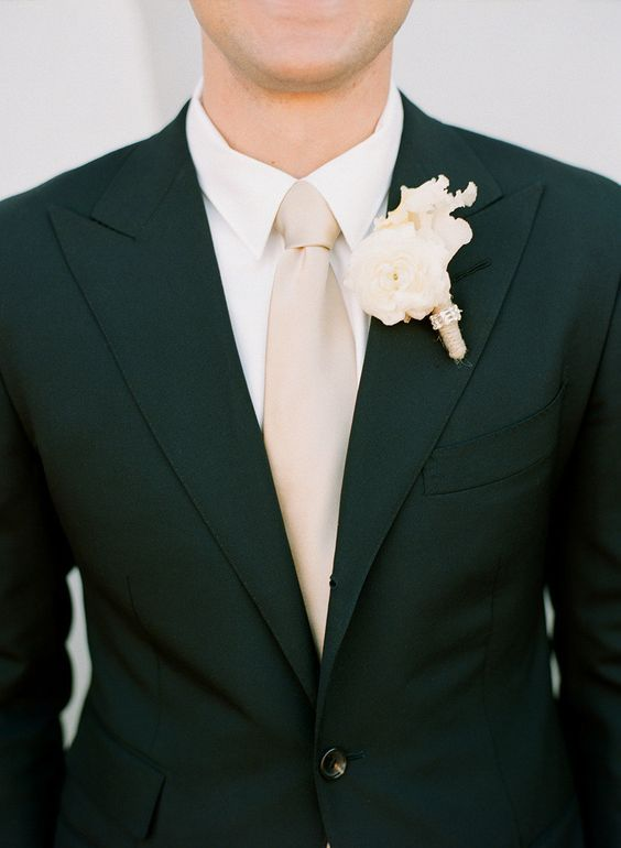 30 Chic Blush And Black Wedding Color Theme Ideas: #1. A black suit, a blush tie and an ivory shirt and boutonniere