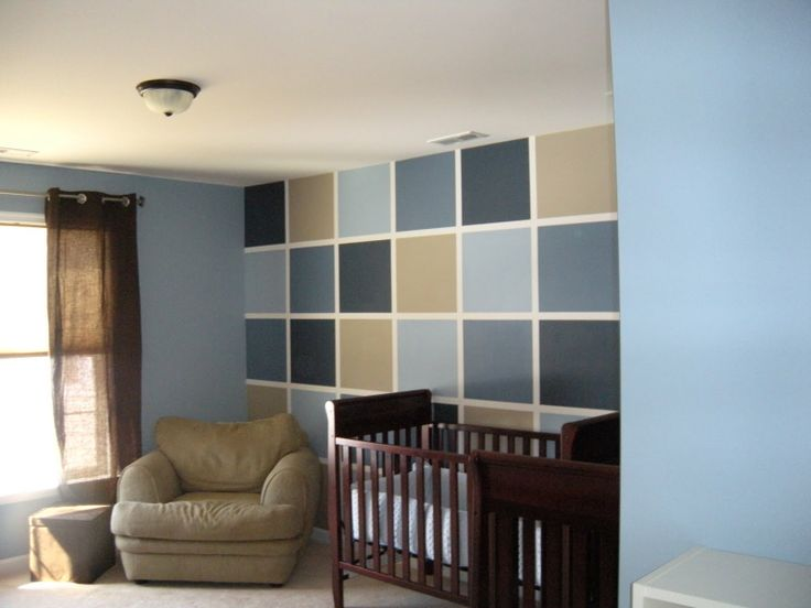 Love the checkerboard painted wall! And what a cute nursery look. :)