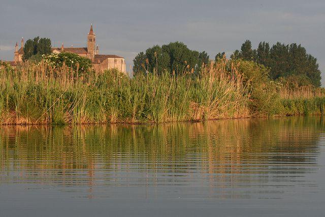 Amazing glimpse of Santa Maria delle Grazie basilica from the near river..