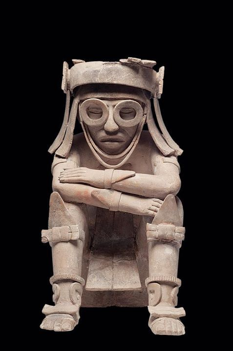 Tlaloc, Aztec god of rain, water, and fertility, usually shown with goggles.