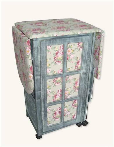 "IRONING DAY STATION   Chintz and dove grey cabinet with French door offers stash drawers and cubbies.  Caster wheels.  33 x 20 x 13"" extended. 58"" ironing board. $200."