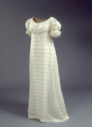 """White mull dress with yellow floral print, Danish, c. 1820. Although Danish women embraced the fashions of the French Empire, the thin fabric preferred for dresses was hardly suitable for Danish winters. A saying quickly sprang up that women """"dressed in French and froze in Danish."""" This was no doubt also true for other less temperate climates. This dress probably belonged to Hedvig Marie West, née Schumacher."""