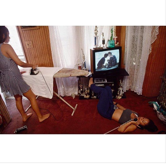 One more from Joseph Rodriquez, if you're not already following his IG account @rollie6x6 then change that now. 'From the book RESPEKT, Cindy, from El Sereno, irons her boyfriends t-shirt while her sister Veronica, 13, is on the phone, making plans for the weekend. The sisters' softball and basketball trophies take center stage in the family living room. Los Angeles, CA 1995.'