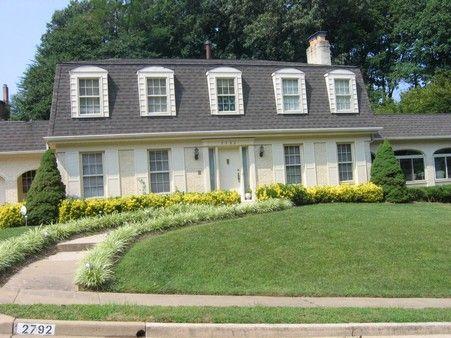 Mansard roof w/dormers. Like this but 3 windows across.