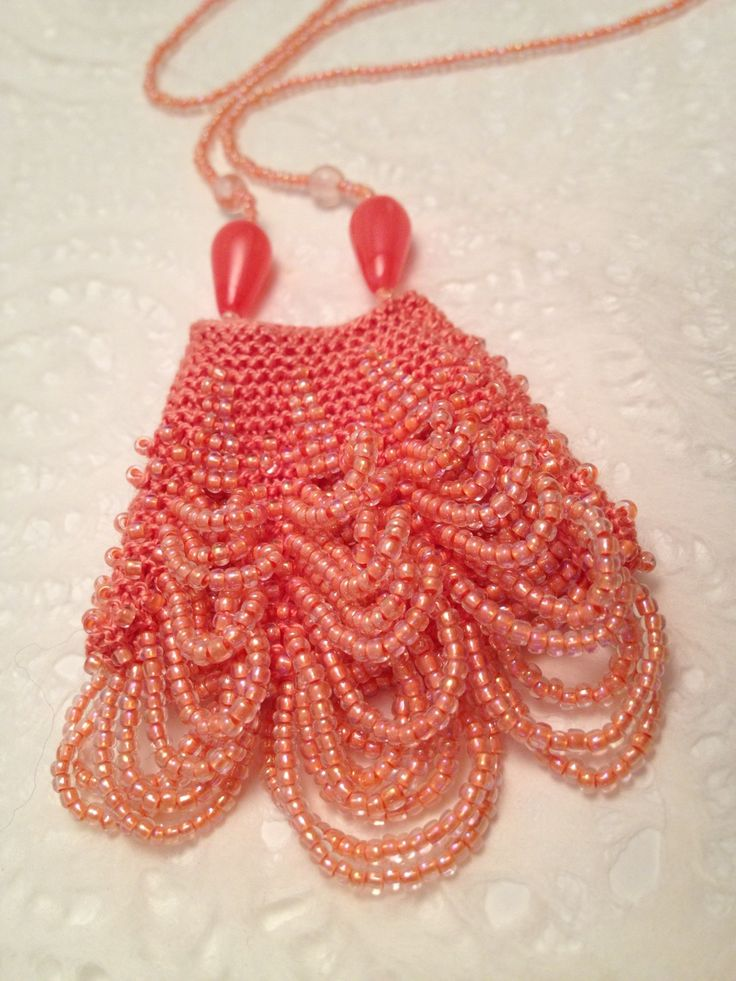 Knitted with beads amulet pendant