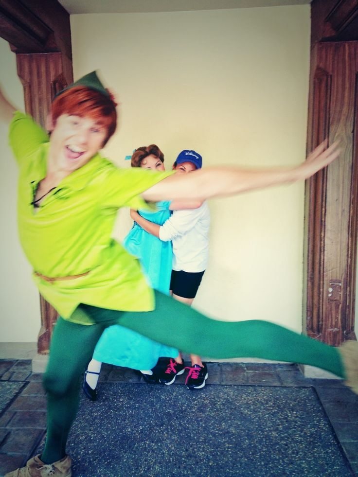 Photobombing level: Peter Pan. I wouldn't even ask for a redo shot. This has to be framed.