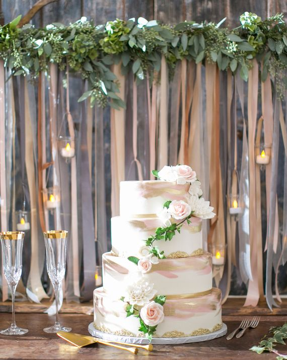 Amber from Sweet on Cake shaped this cake in an oval, to complement the oval tables at the reception. The blush, gold, and white four-layer cake consisted of strawberry basil, caramel toffee, milk and cookies, and lemon blackberry flavors.