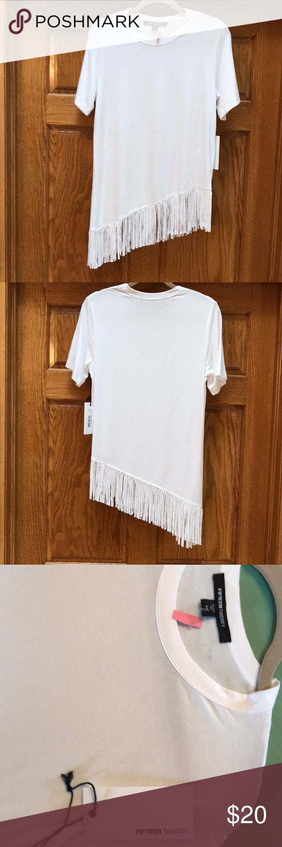 """Fifteen Twenty Asymmetrical White Tee Size M Soft, white fringed Fifteen Twenty tee is just plain fun. Size medium, it is 28"""" from right shoulder to the hem excluding the fringe which is 5"""" additional. The bust is a generous 38"""". Fifteen Twenty Tops Tees - Short Sleeve"""