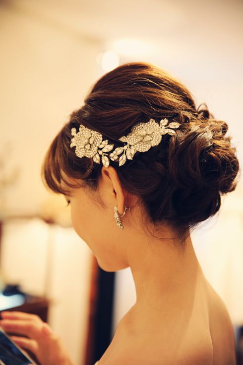 A nice updo with an off the shoulder look. The small floral is probably repeated on the other side. A nice prom look, a bridal look or a look for one of your ladies.