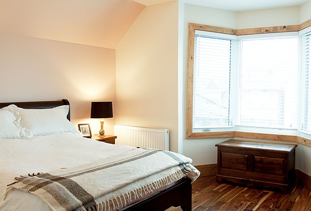 Brock Street Renovation - The master bedroom at the front is flooded with natural light from the original bay window.