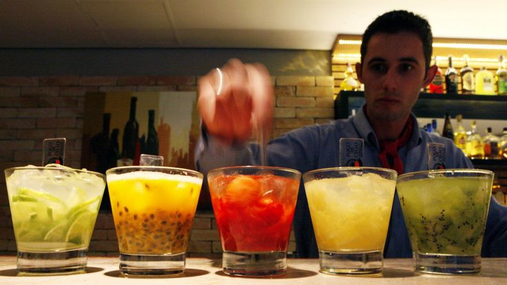 A barman prepares caipirinhas, Brazil's national cocktail, made with cachaca (sugar cane hard liquor), sugar and lemon or another fruit, in a restaurant in Sao Paulo in this picture taken April 15, 2014. A sprawling metropolitan area of nearly 20 million people, Sao Paulo is sometimes referred to as the New York of South America. While the comparison may be a bit overstated, Brazil's business capital boasts a rich cultural life and a bar and restaurant scene that rival the world's premier…