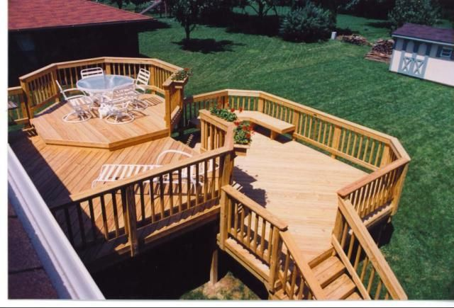 Multi level pressure treated wood custom designed deck for Multi level deck design