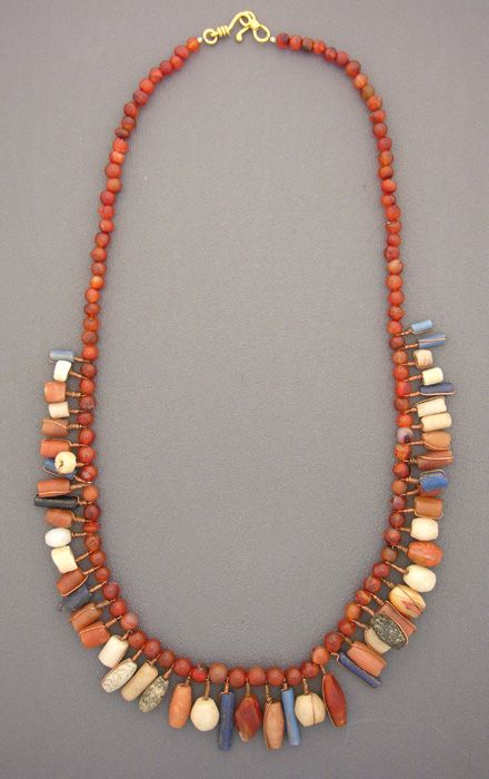 by Anne Holland |  Antique carnelian, quartz, granite, and glass beads from the African  nation of Mali, originally made to be woven into women's hair, are now  interspersed between a beautiful strand of antique carnelian beads |  Dorje Designs | SOLD
