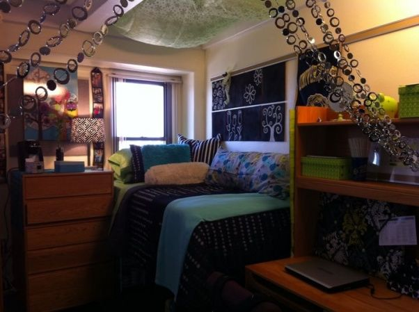 My daughters space at Pitt, Small dorm space decorated in black, white, green and blue.  , Comforter from Target and cork boards on wall were spray painted black with a simple hand painted design.I found this idea online. Beads can either hang down or be pulled backed. , Dorm Rooms Design
