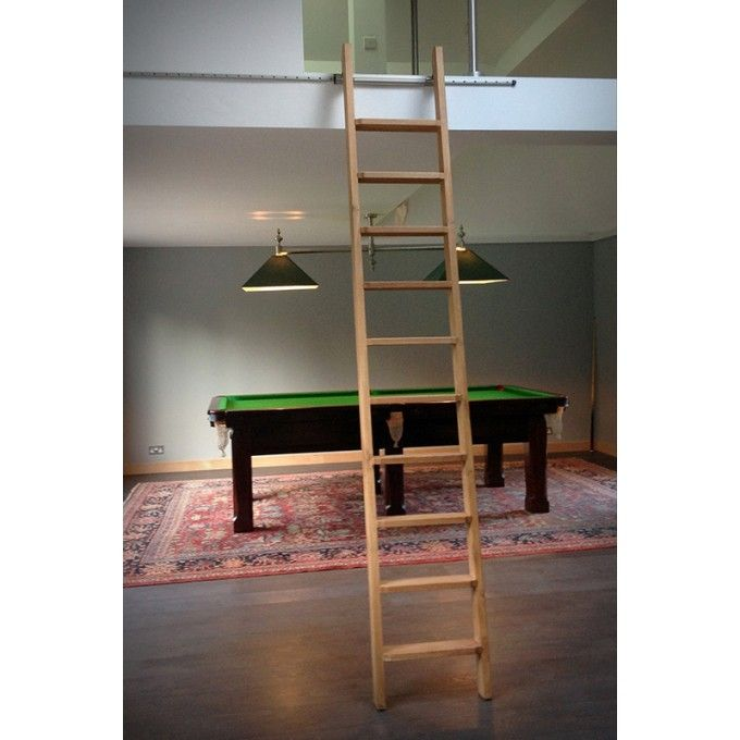 Rolling Ladder provided to private residence for access to mezzanine floor http://www.ladderstore.com/blog/rolling-library-ladder-provides-access-to-mezzanine-gym/