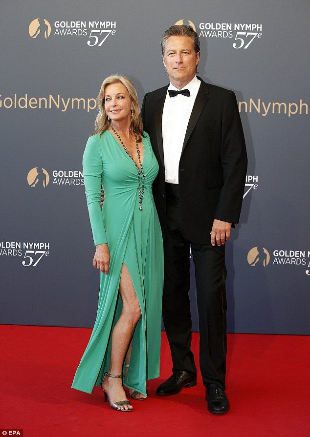 Loved-up: The 60-year-old truly dazzled in a striking emerald green gown as she paraded th...
