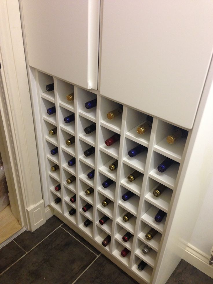 Bespoke wine rack and cupboard by Anthony Mullan furniture.