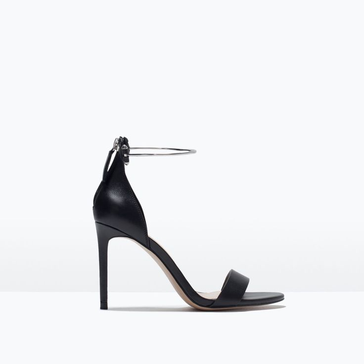 Zara  LEATHER HIGH HEEL SANDAL WITH ANKLE STRAP  Black leather high-heeled sandals. Metallic ankle strap detail. Fine strap at toe. Stiletto heel. Zip closure on heel.
