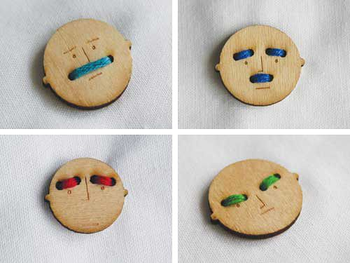 Mr Button has holes that add character to his face depending on which holes you use and what color thread.