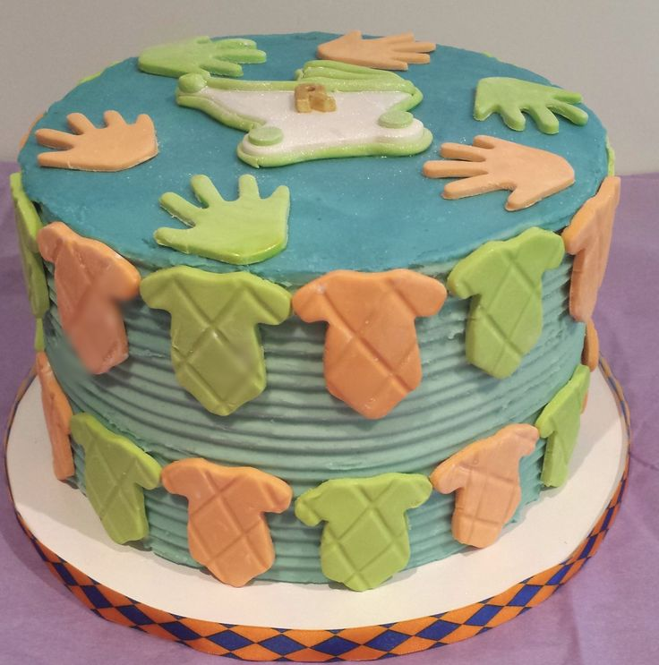 Baby Shower cake. Covered in Buttercream with fondant designs