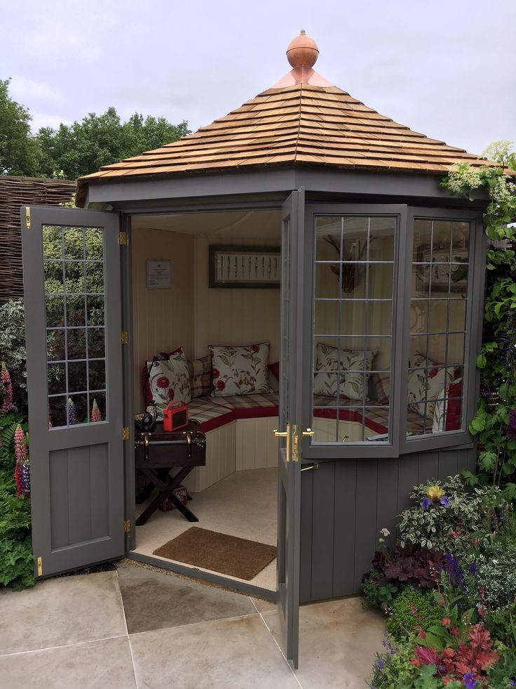 3m octagonal Burghley summerhouse painted with cedar shingle roof and beautiful internal upholstery and seating. Comes in 2 sizes.