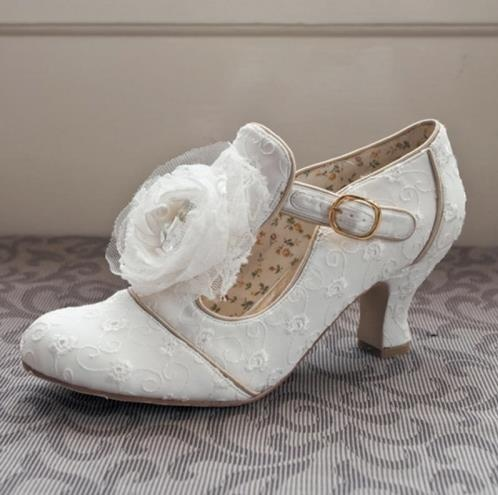 """Dorothy"" in ivory. Only £78!    Beautiful vintage shoes. Closed toe with a strap around the ankle and a large flower on the front, as well as floral embroidery across the shoe, a very elegant classic pair of shoes.    Heel height 60mm (2 3/8"")  Available in sizes 3 - 8    http://www.vintageaddress.com/Dorothy/p1143724_5247492.aspx"