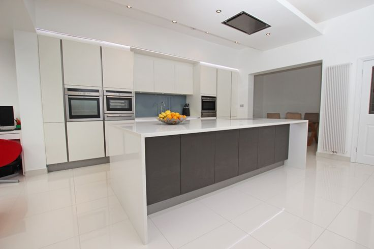 Spacious White Kitchen with Island - Contemporary white kitchen with grey two tone island - Discover more at www.lwk-home.com