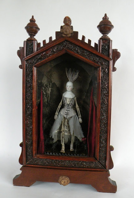 ONE STEP BEYOND......and then its curtains.   -  Antique gothic clock case, Victorian doll parts, and fabrics, resin bones, vintage ephemera, silk curtains. Jennie Sharman-Cox