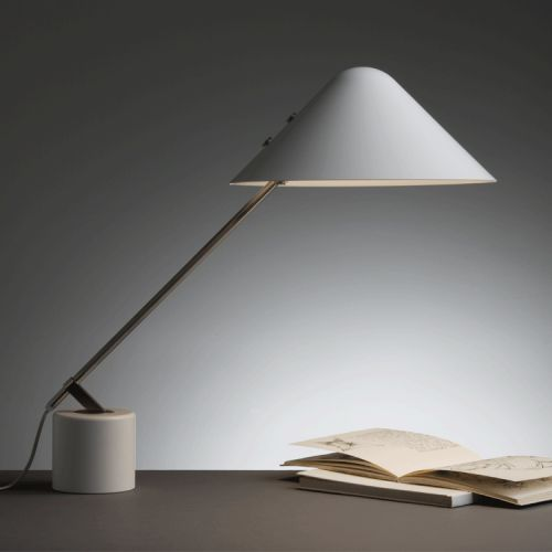 Swing VIP Table lamp  Immediately recognized for its architectural qualities the Swing VIP conquered the front pages of architectural magazines around the world when first introduced and was bought by The Danish Arts Foundation. The Swing VIP is still considered to be an icon.