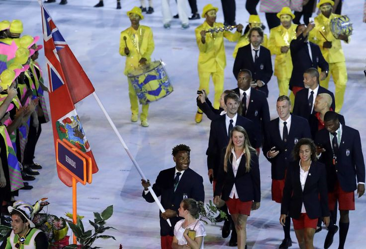 Long jumper Tyrone Smith carried the 2016 Bermuda flag as he led the island's athletes during the opening ceremony for the  Olympic Games in Rio de Janeiro